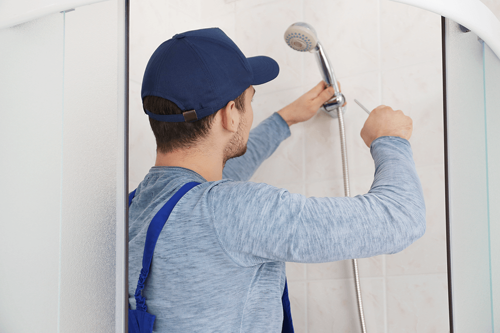 Plumber Removing Shower Head